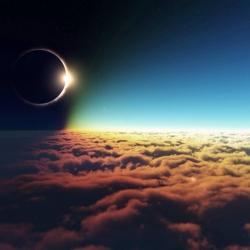 Zaćmienie słońca widziane znad chmur.