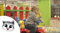 Kids indoor playground with many toys: balls, sliders, cars.  Kids playing KIDS TOYS